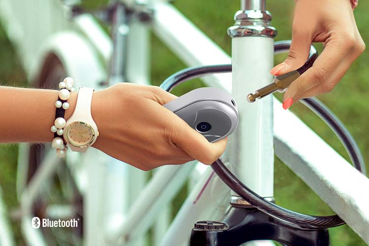 Closeup of a woman securing her electric bike with a TL113 Digital Bike Lock.