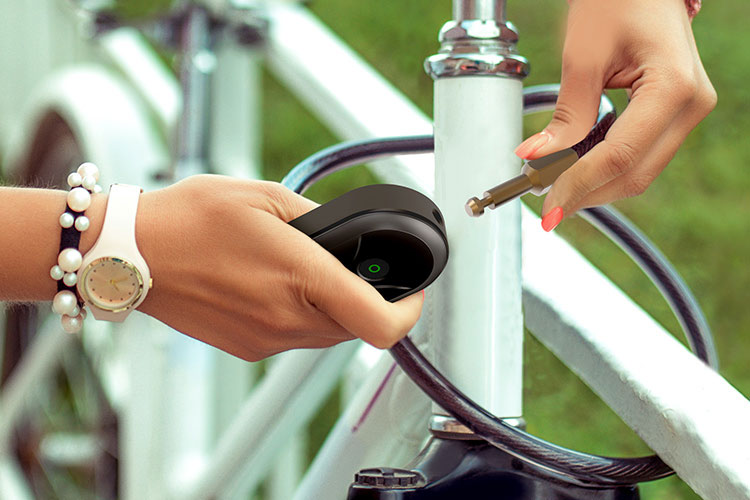 Woman locking her electric bike with a TL113 Smart Bike Lock.