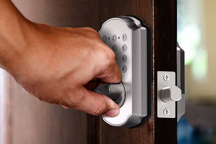 Closeup of a man opening the TL114/TL115 Smartbolt Digital deadbolt.